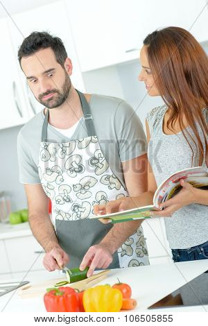 Couple stood in a kitchen
