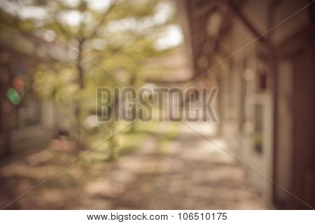 Blur Image Of Long Empty Corridor With Open Space To The Green Garden With Bokeh
