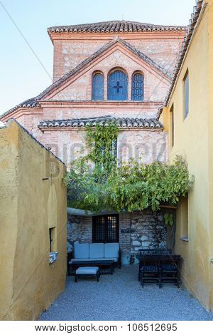 Warm Courtyard With Tables And Chairs Spain