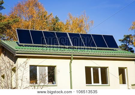 Household With Solar Panels On The Roof