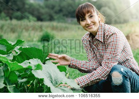 Happy Gardener Posing With Plants
