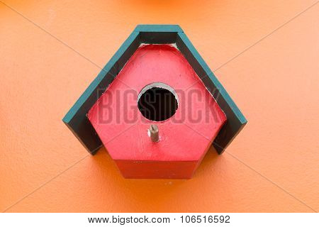 Colorful Bird Nest Wood Box Decorated On Orange Wall Background