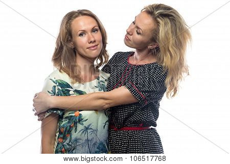 Pitying blond mother and daughter