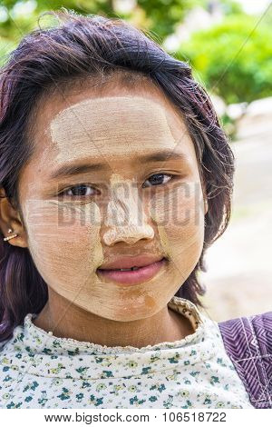 Portrait Of Young Burmese Woman With The Typical Face Make Up