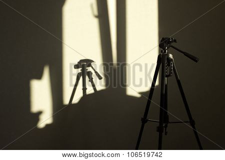 tripod and a shadow of it