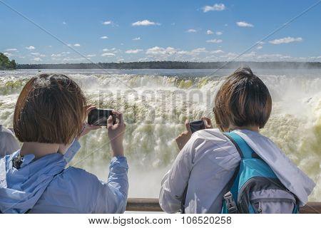 Tourists Taking Photos Of Devil Throat At Iguazu Park
