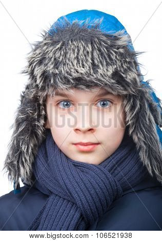 Kid wearing blue faux fur trapper hat and scarf on white background