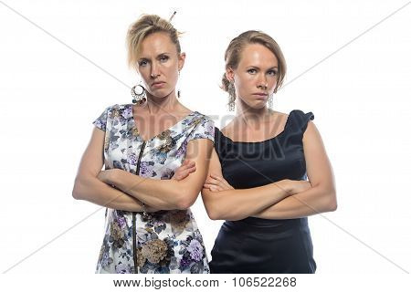 Isolated portrait of two serious sisters on white