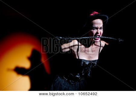 Lady In Black Carries Whip
