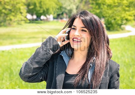Young Business Woman In The Park With Smartphone Having A Break After A Working Day - Modern Concept