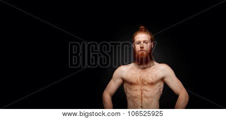 Portrait Of Muscular Bearded Man Isolated On Black Background.