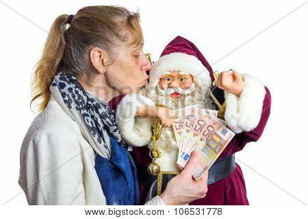 Woman Kissing Model Of Santa Claus