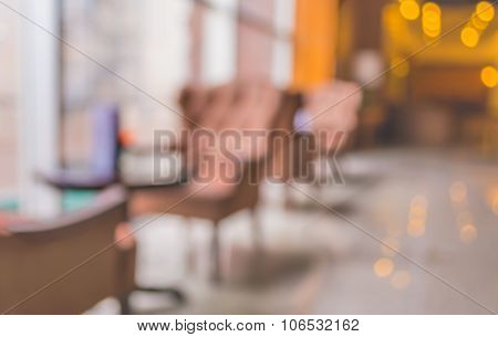 Blur Image Of Beautiful Vintage Sofa Next To Window In Lobby
