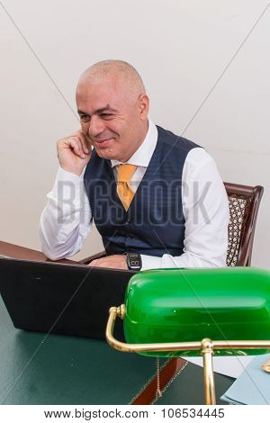 Businessman Uses Laptop, At Desk, At Work.