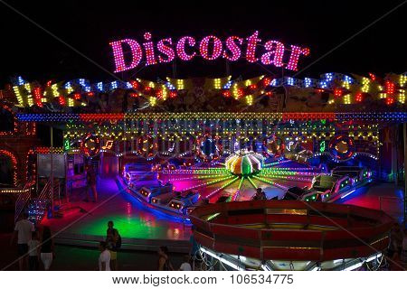 ODESSA UKRAINE - JULY 12 2015: colorful carousel with lights at night August 12 2015 in Odessa Ukrai