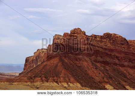 Mountain Peek Of Spotted Wolf Canyon With Dramatic Clouds In Sky