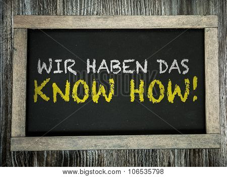 We Have the Know-How (in German) written on chalkboard