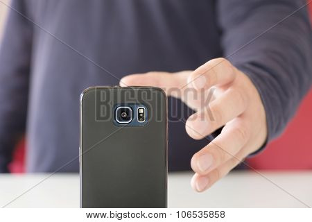 hand grasping a smartphone