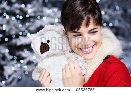 Christmas Woman Smiling With Gift, Owl Plush Toy,
