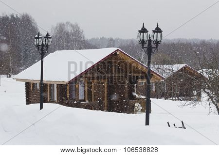 Wooden House In Winter In The Snow.