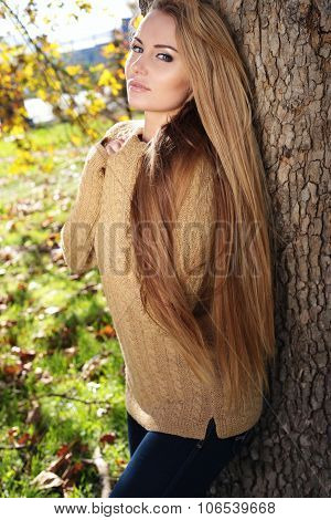 Blond Woman In Casual Cozy Clothes, Posing In Autumn Park