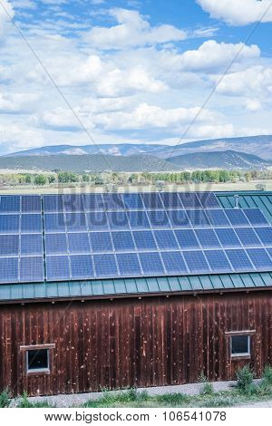green house powered by solar panels in the mountains