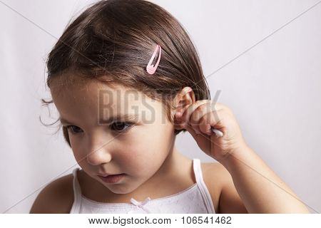 Using Cotton Bud To Clean Her Ear By Himself