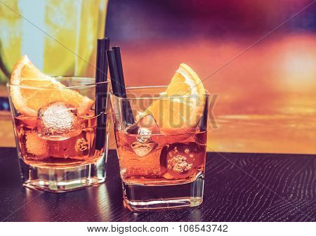Glasses Of Spritz Aperitif Aperol Cocktail With Orange Slices And Ice Cubes On Bar Table, Vintage At