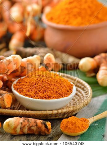 Turmeric Roots In The Basket On Wooden Table