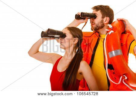 Lifeguards With Ring Buoy And Life Vest.