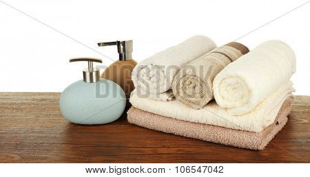 Soft towels with dispenser isolated on white