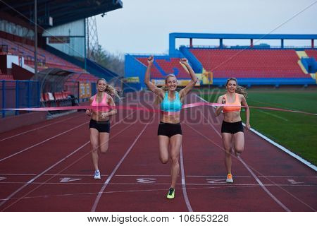 Female Runners Finishing athletic  Race Together