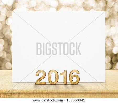 White Poster And 2016 Year Wood Texture With Sparkling Gold Bokeh Wall And Wooden Table