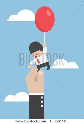 Businessman Flying Away With Balloon But Being Hindered By Large Hands