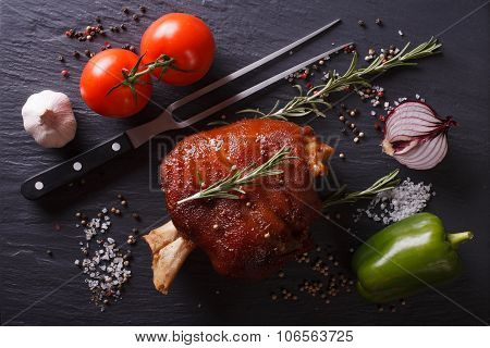 Baked Pork Shank, Vegetables And Spices On A Slate. Horizontal Top View