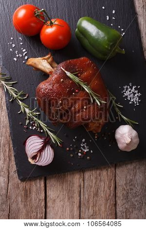 Baked Pork Shank And Vegetables On A Slate Board. Vertical Top View