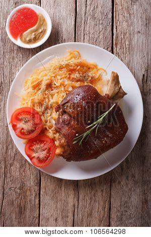 Pork Shank, Sauerkraut And Sauce. Vertical Top View