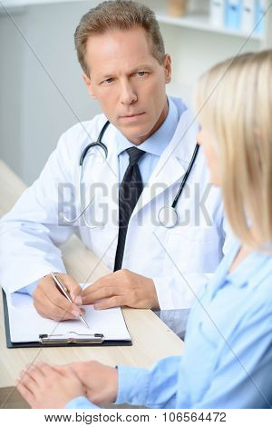 Professional doctor examining his patient