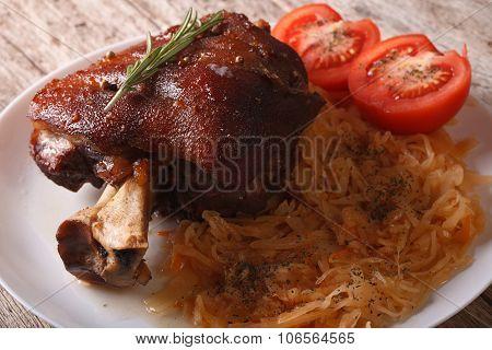 Baked Pork Shank And Sauerkraut Closeup On A Plate. Horizontal