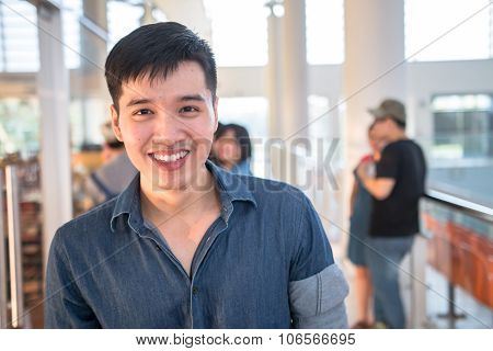 Portrait of a young asian male student in campus