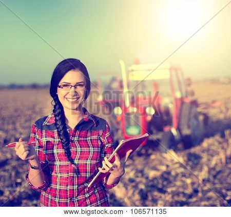 Woman With Tractor On The Field