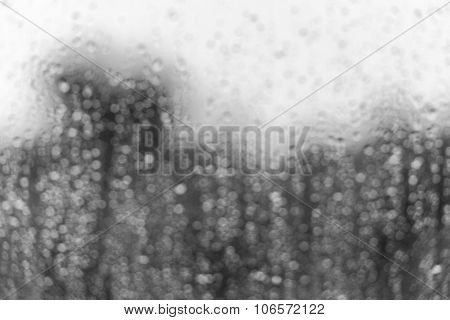 Rain Water Drops On A Window Glass Defocused