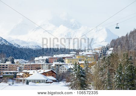 View to the buildings and cable car gondola in St. Moritz, Switzerland.