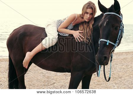 Beautiful Woman With Dark Hair Posing With Black Horse