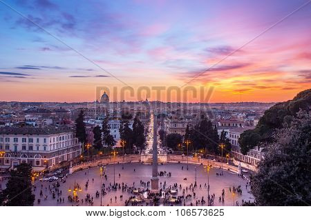 Cityscape Of Rome, Italy At Sunset, With Piazza Del Popolo Lit By Street Lanterns