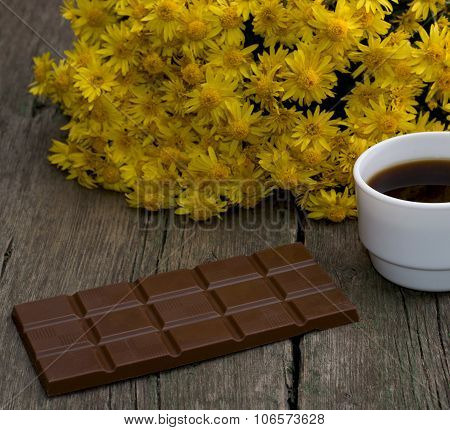 5?Bouquet Of Yellow Flowers, Tile A Chocolate And Coffee, On A Wooden Table, A Still Life
