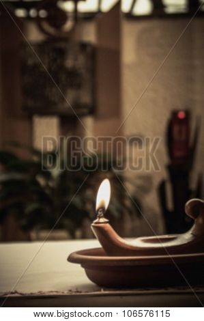 Artistic Abstract Dark Blur Edit Of An Oil Lamp Or Candle In A Dark Church