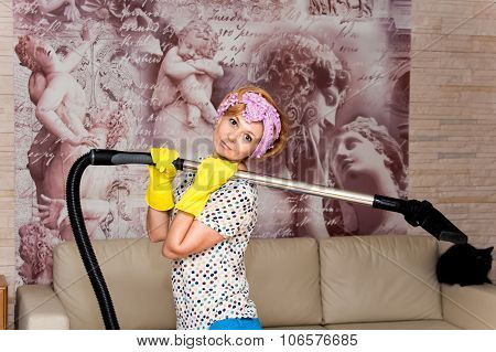 Housewife With Vacuum Cleaner In The Living Room