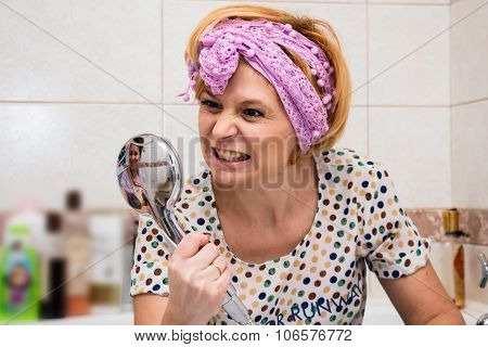 Housewife Is Cleaning Up In The Bathroom