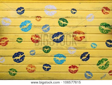 Abstract lips painted on yellow shed
